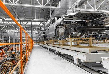 car factory, car body on a conveyor.